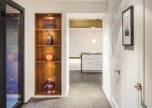 Lighting-for-the-sleek-wooden-corner-shelf-steals-the-spotlight-in-this-hallway-95380-217x155