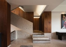 Limestone-and-wood-entry-of-the-house-with-curated-wall-art-71381-217x155
