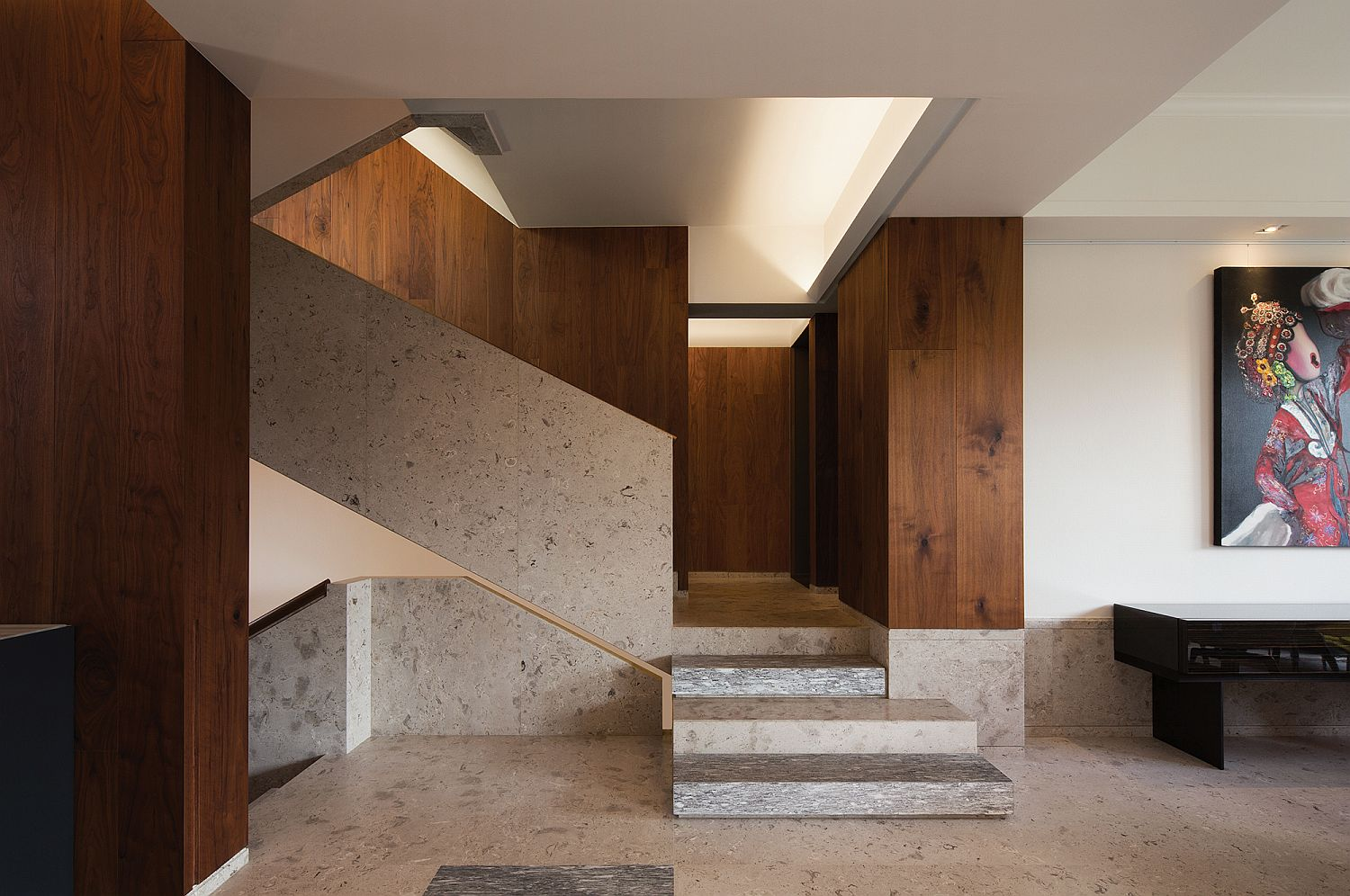 Limestone-and-wood-entry-of-the-house-with-curated-wall-art-71381