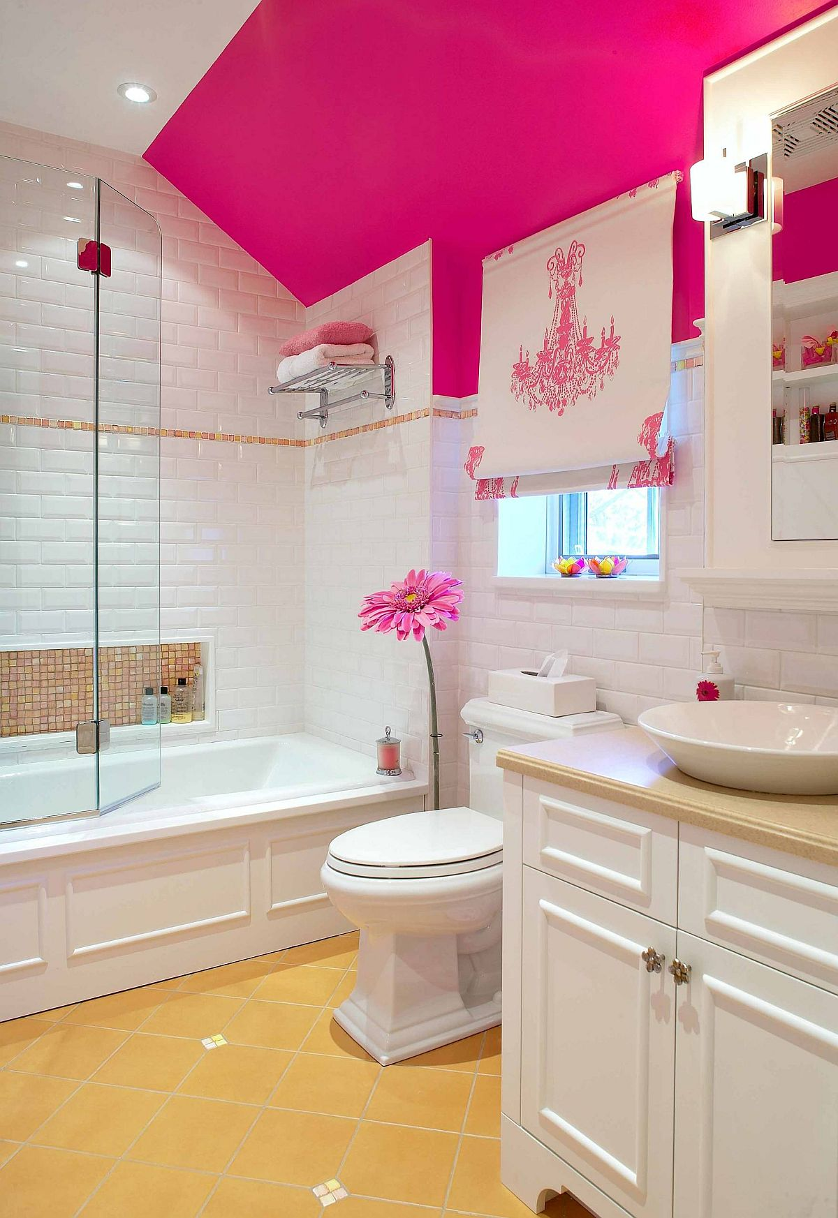 Little pops of pink accentuate it presence in this lovely modern white bathroom