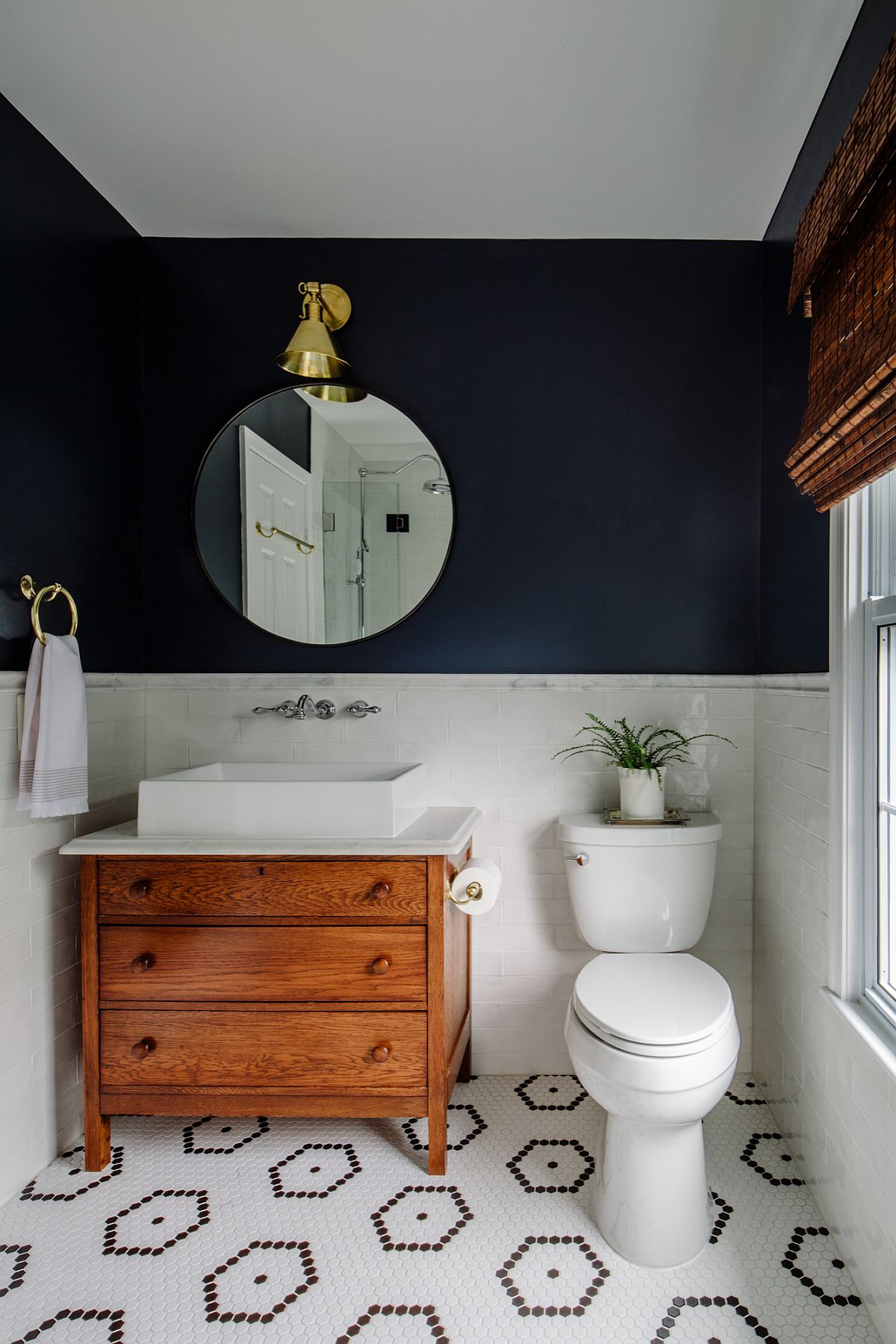 Love the visual balance created by deep Navy Blue and white in his small modern bathroom
