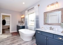Master-bathroom-in-gray-with-wooden-floor-and-a-bright-blue-vanity-11327-217x155
