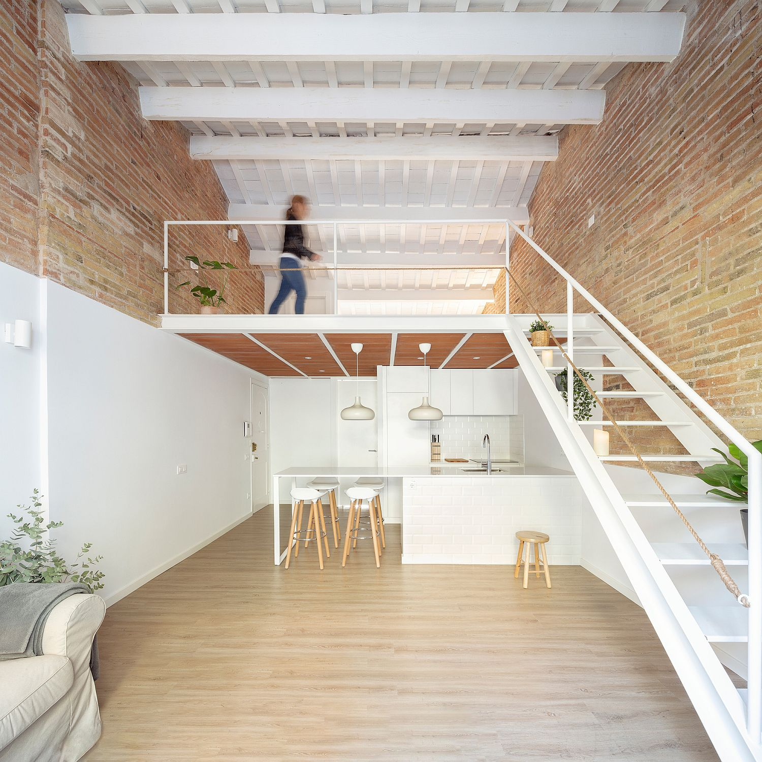 Mezzanine level of the small Barcelona apartment adds precious additional space inside the tiny setting