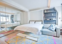 Minimal-bedroom-with-mirrored-wardrobe-doors-and-a-cheerful-ambiance-90327-217x155