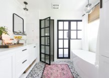 Modern-beach-style-bathroom-in-white-with-dark-framed-doors-in-glass-and-an-understated-pink-rug-21426-217x155