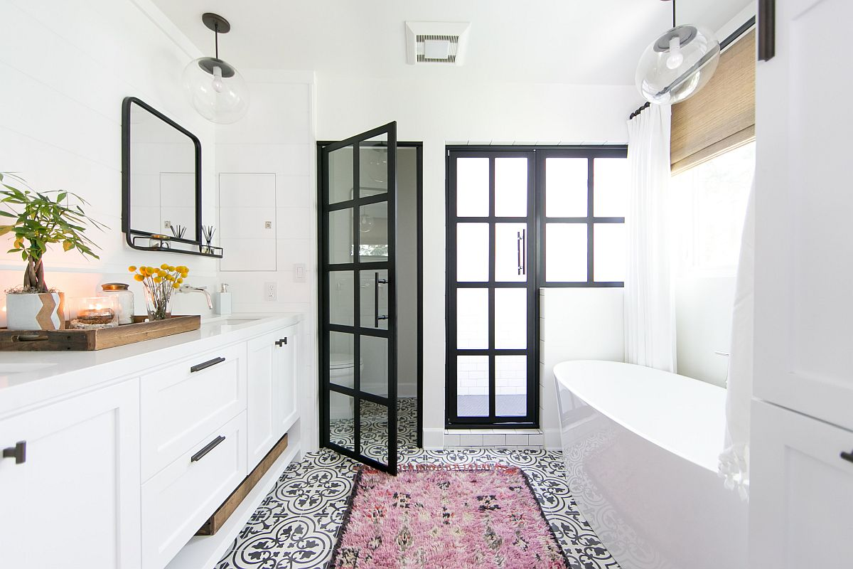 Modern beach style bathroom in white with dark framed doors in glass and an understated pink rug