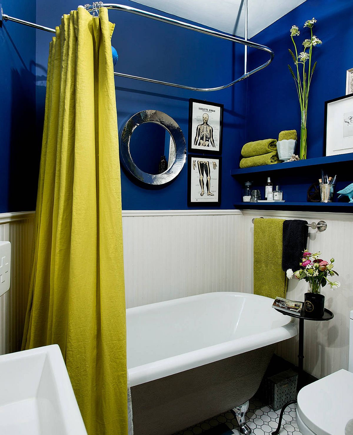 Modern eclectic bathroom in blue and white with greenish-yellow thrown into the mix