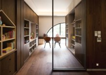 Modern-home-office-with-ample-shelf-space-and-a-whole-lot-of-wood-all-around-52894-217x155