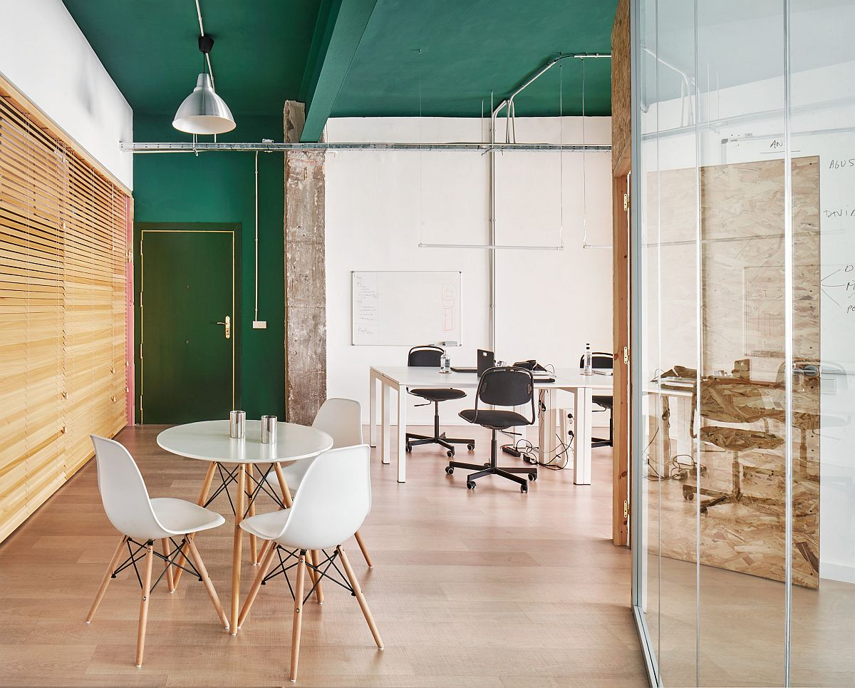 Modern industrial office with green ceiling and white decor