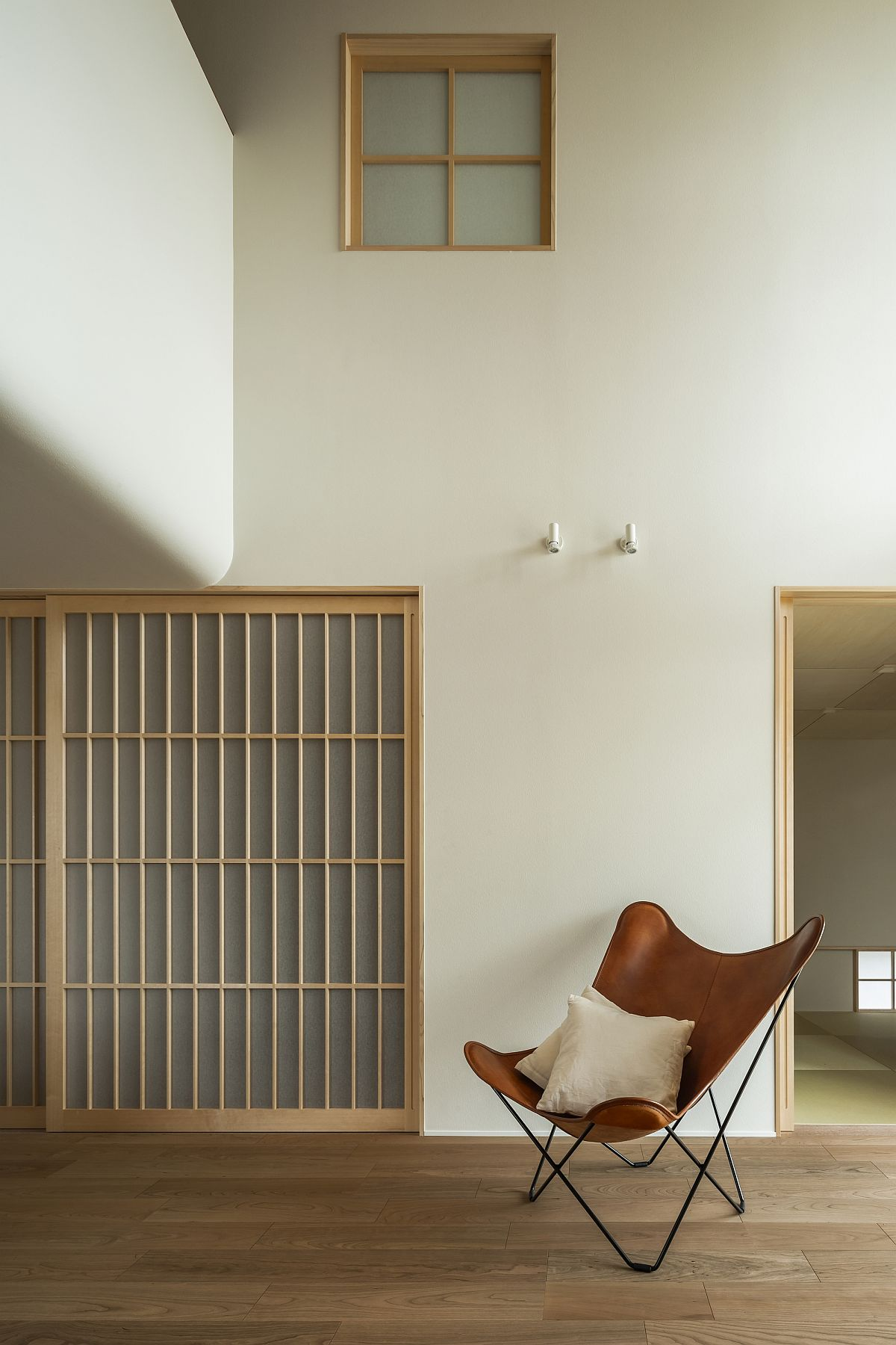 Modern minimal interior of the Japanese home in wood and white feels elegant