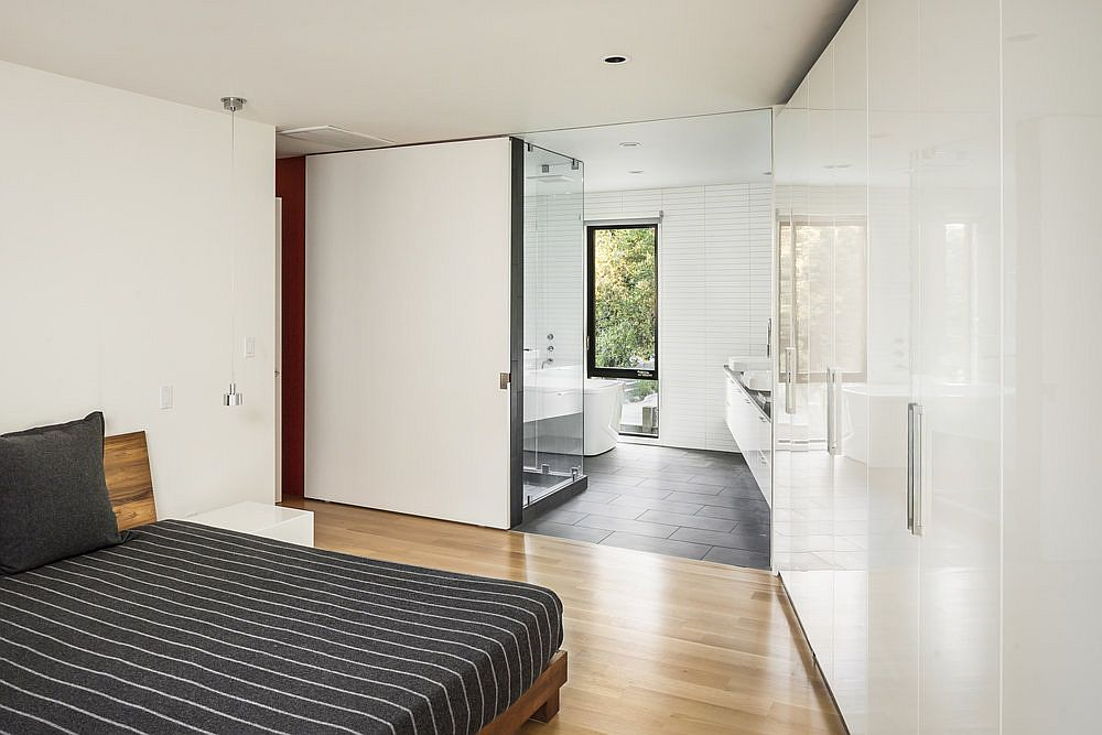 Modern minimal master bedroom of the single-family home with wood and gray floor