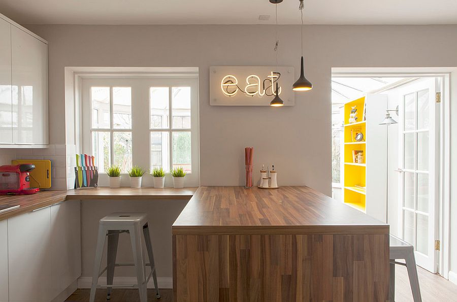 Modest modern kitchen in gray feels far more brighter thanks to the neon sign