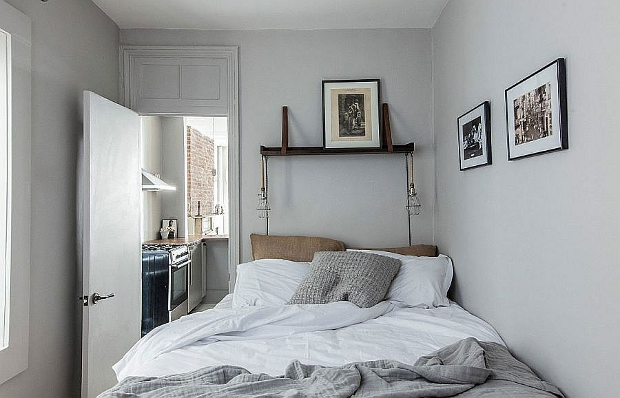 Monochromatic-bedroom-with-limited-space-and-black-and-white-photgraphs-on-the-wall-80440