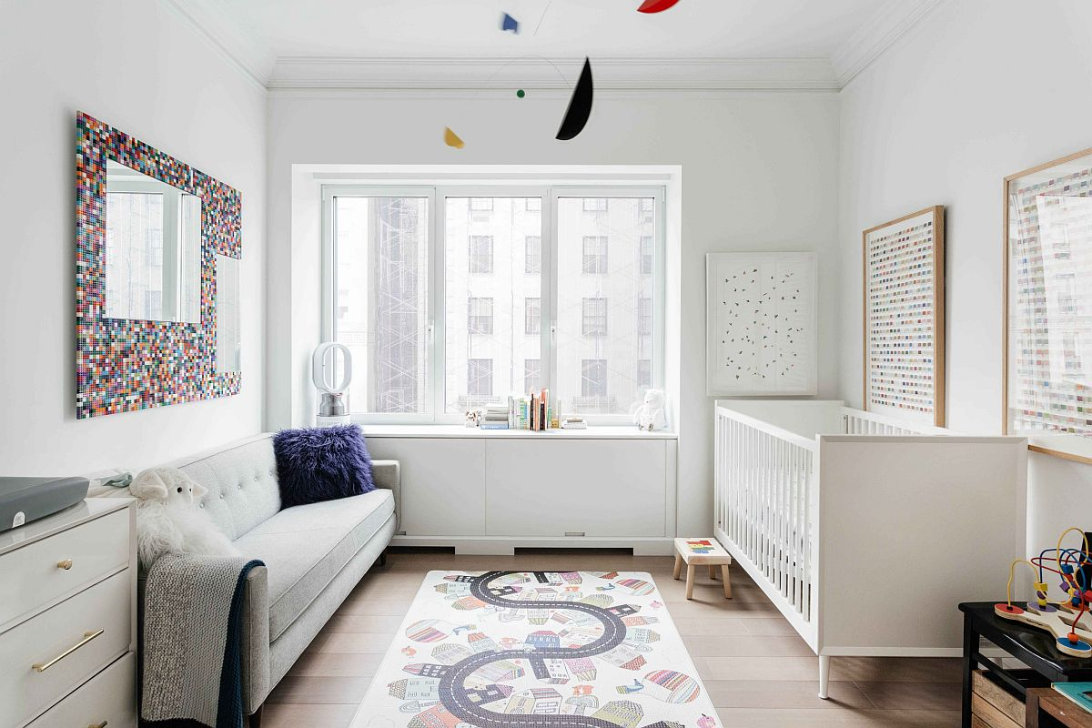 Monochromatic contemporary nursery in white feels cheerful and stylish