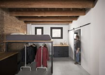 Multi-tasking-interior-with-brick-walls-and-wooden-ceiling-31349-217x155