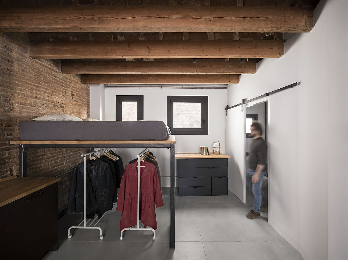 Multi-tasking interior with brick walls and wooden ceiling
