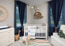 Navy-blue-curtains-bedding-and-accessories-accentuate-the-beach-style-of-this-nursery-87367-217x155