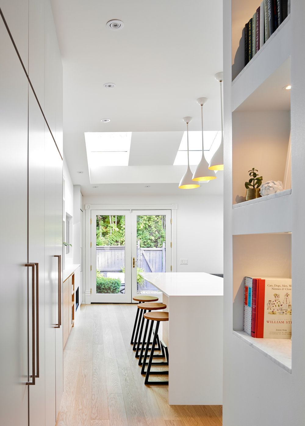 New kitchen and dining area of the house in white with ample natural light