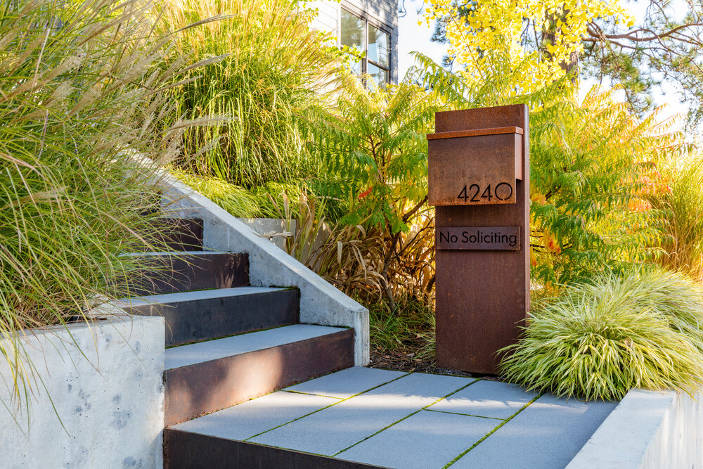 New post box of the house with custom metal design also displays the number