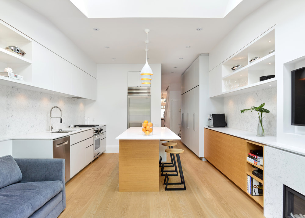 Oak, marble and polished surfaces transform the interior of this Toronto home