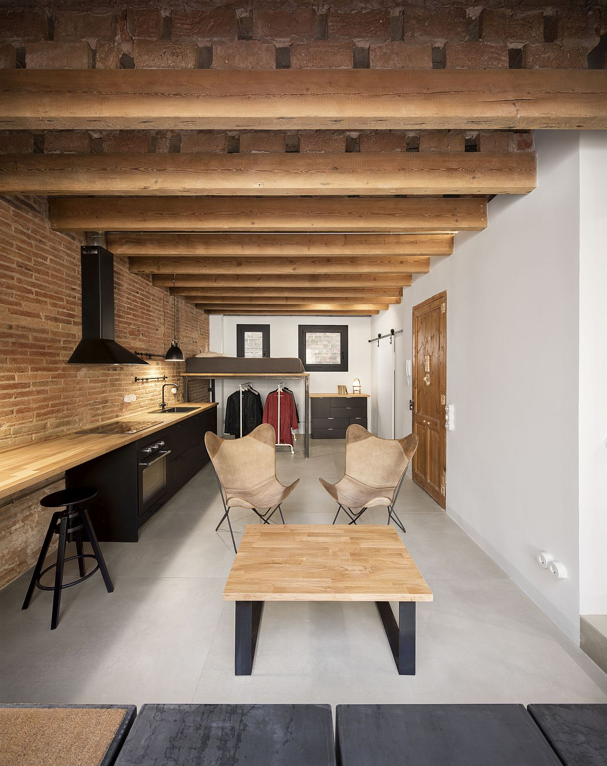 Old unused penthouse on top of Barcelona building turned into a space-savvy modern apartment