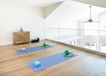 Open-staircase-landing-zone-turned-into-a-cheerful-and-airy-home-workout-zone-29554-217x155