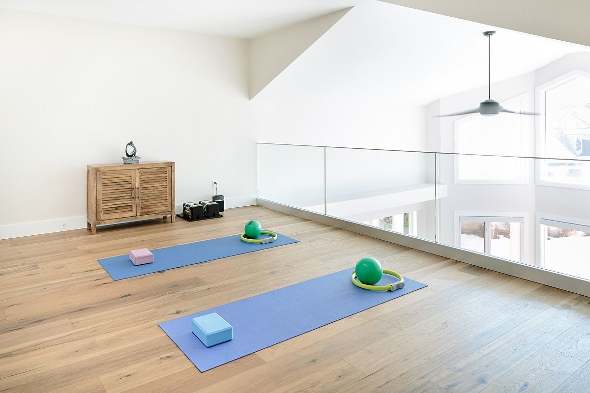 Open-staircase-landing-zone-turned-into-a-cheerful-and-airy-home-workout-zone-29554