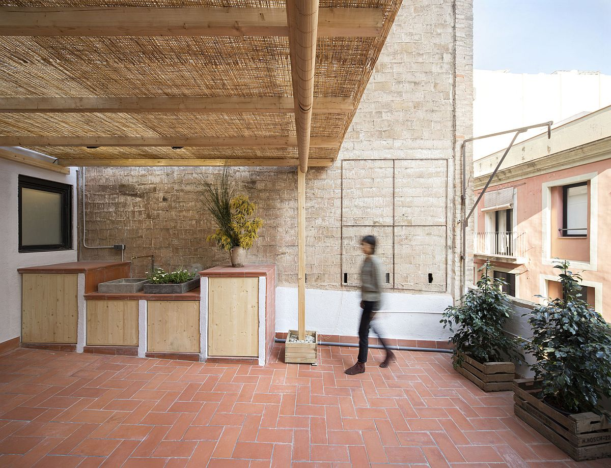 Outdoor kitchen and dining area extend the apartment into the terrace