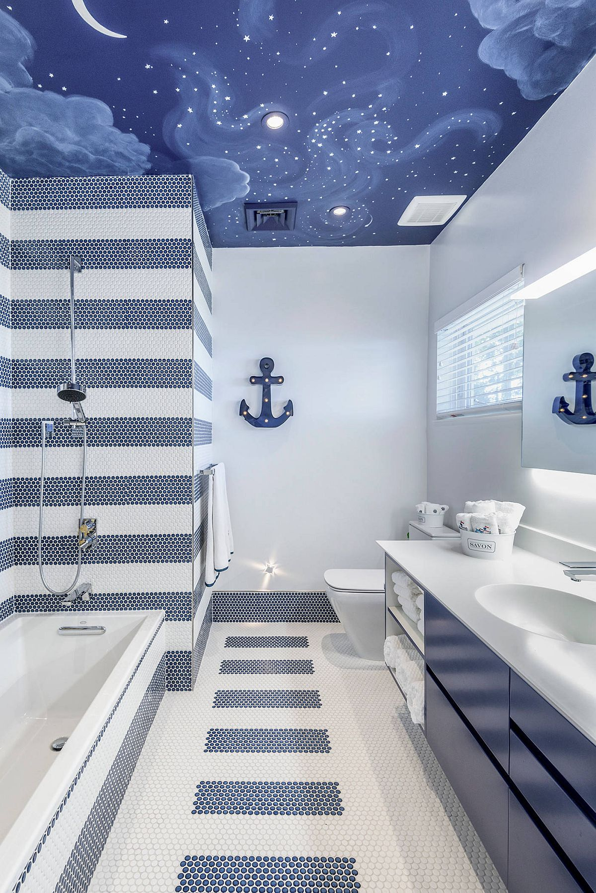 Painted ceiling and lovely use of blue and white tiles creates a stylish kids' bathroom