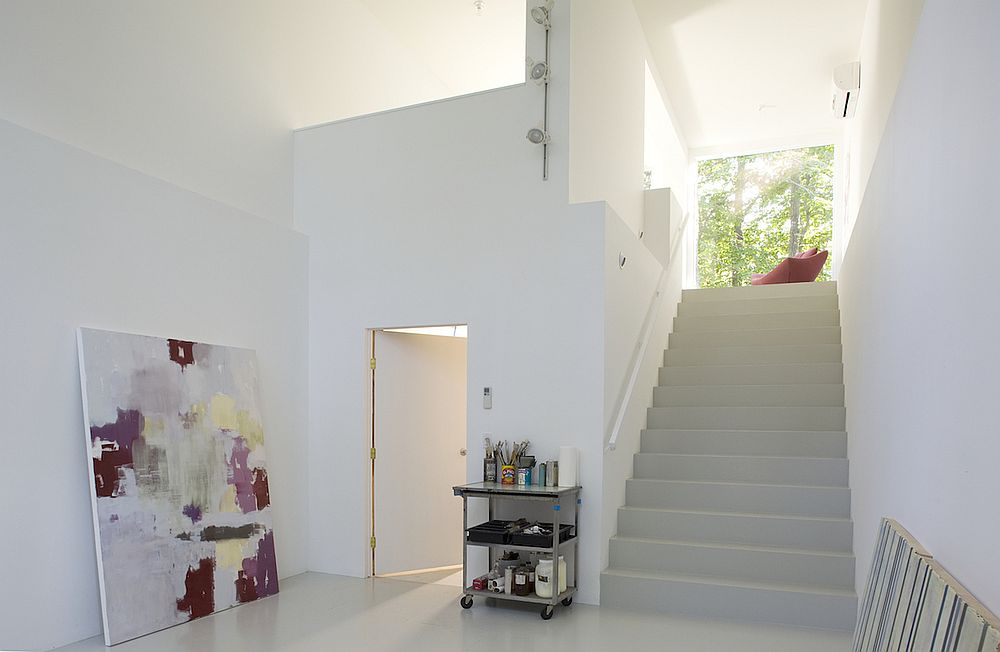 Painting Studio on the lower level in white with double-height ceiling and plenty of open space