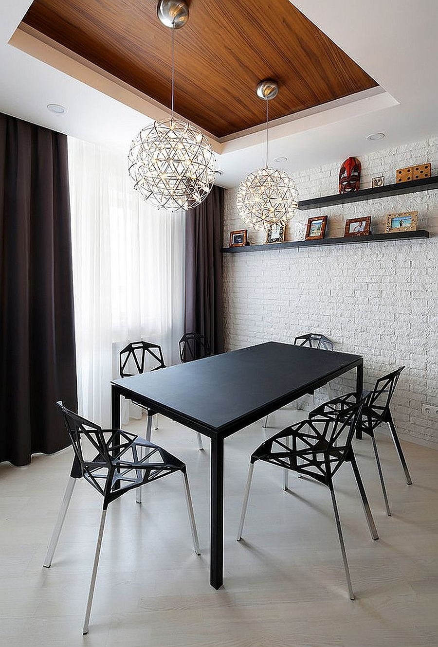 Painting the brick wall completely white works well in contemporary dining rooms