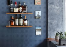 Pegboard-wall-at-the-entrance-of-the-shop-offers-space-to-hang-your-hats-and-coats-96226-217x155