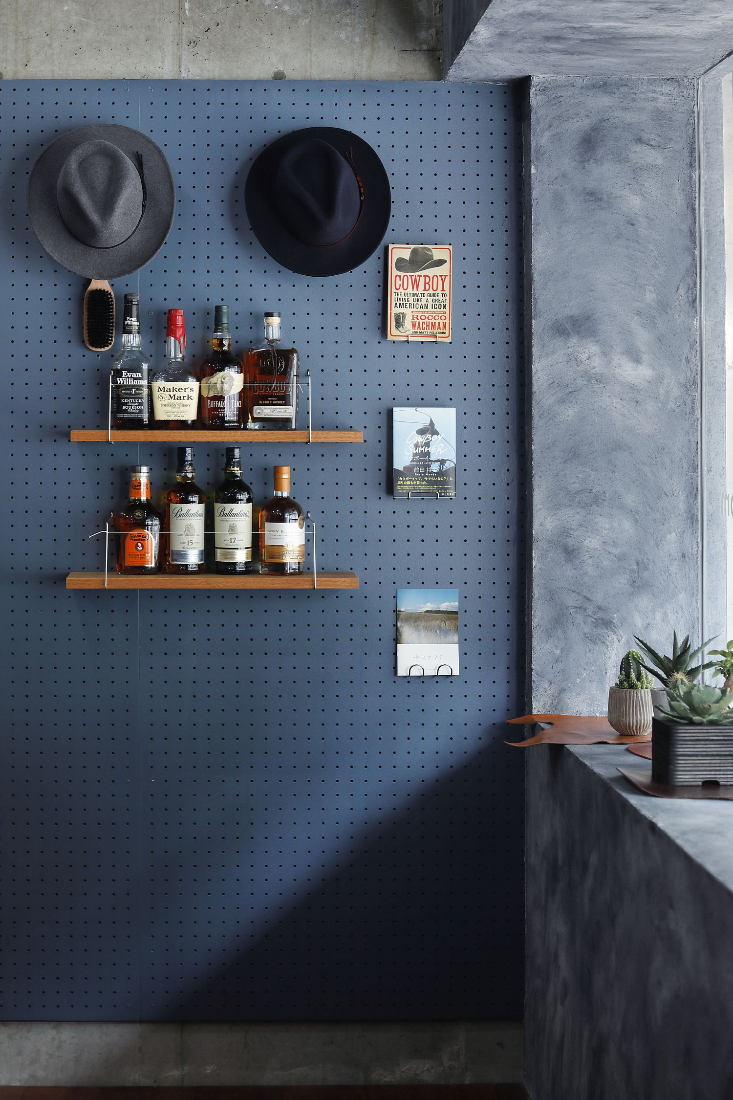 Pegboard wall at the entrance of the shop offers space to hang your hats and coats