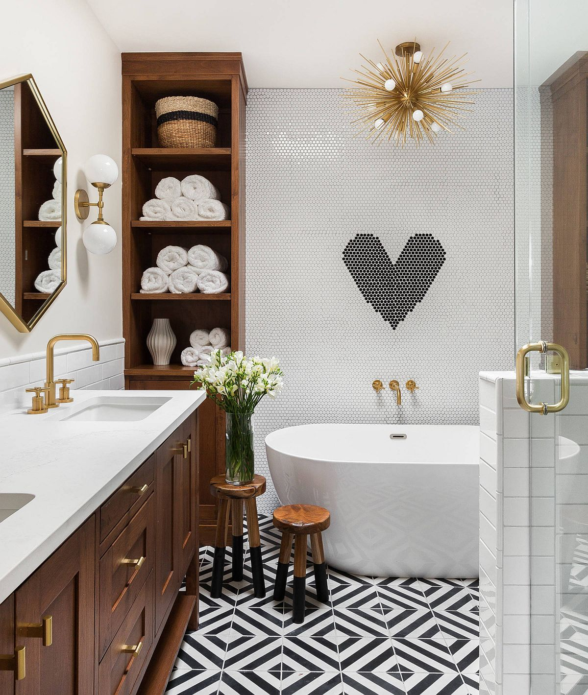 Penny tiles and floor tiles bring pattern to the bathroom in white and black along with wooden vanity