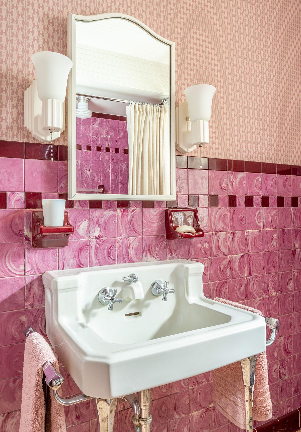 Pink tiles on the wall along with wall-mounted sink for the traditional bathroom remodel