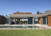 Pool-stepping-stones-and-garden-around-the-house-give-it-a-luxurious-modern-appeal-62802-217x155