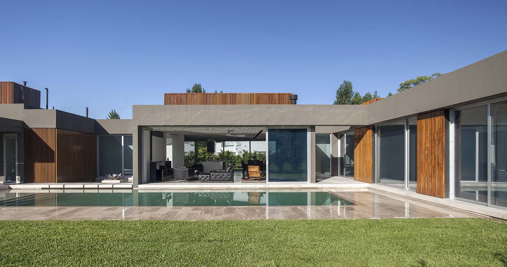 Pool, stepping stones and garden around the house give it a luxurious modern appeal