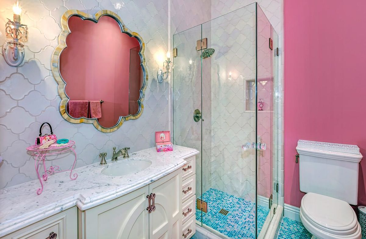 Reflection of the accent wall in the bathroom adds to the pink aura inside
