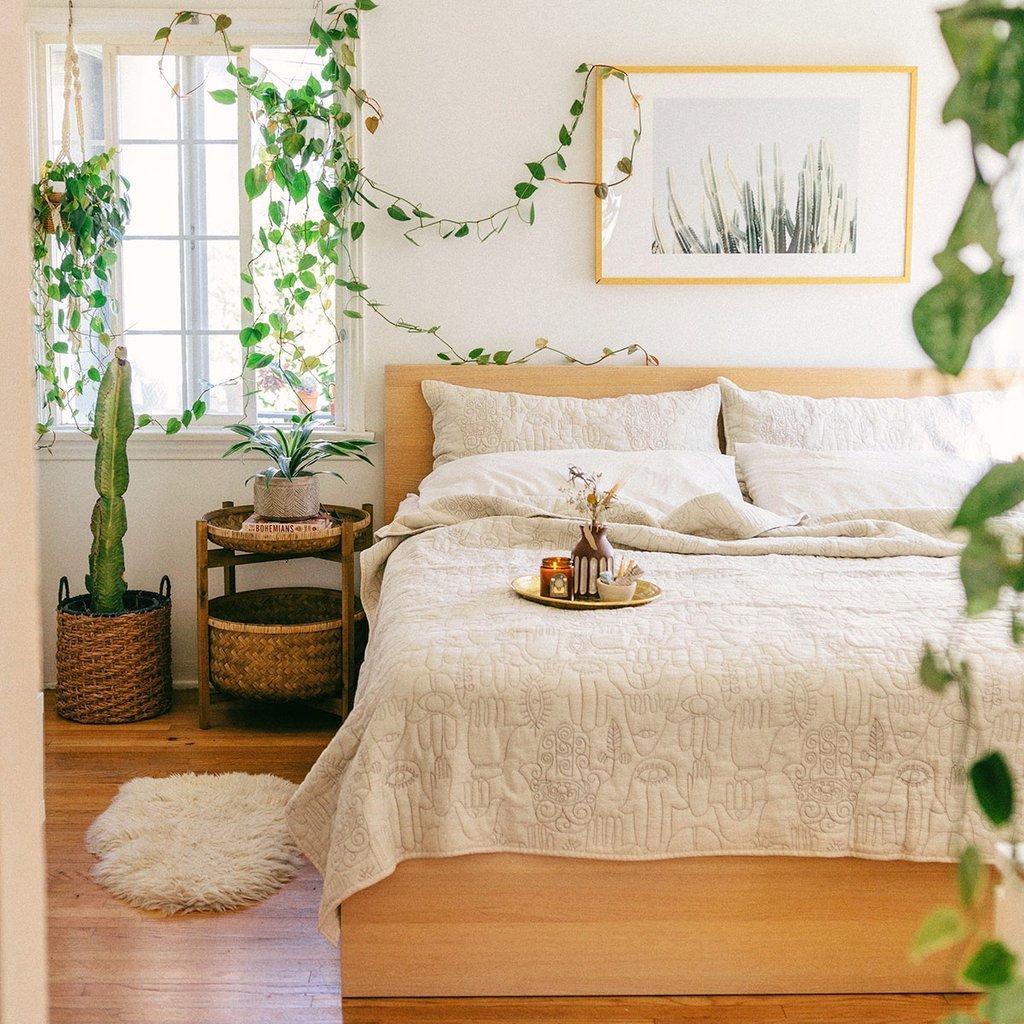 Relaxing bedroom with an abundance of houseplants