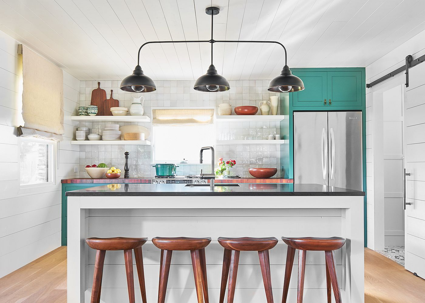 Relaxing ranch style kitchen in white with a splash of teal that brings brightness