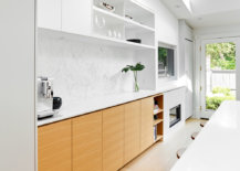 Relaxing-social-kitchen-in-white-with-polished-finishes-and-connectivity-with-the-outdoors-95259-217x155