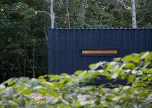 Reused-shipping-containers-painted-black-to-create-modern-New-York-art-studio-33766-217x155