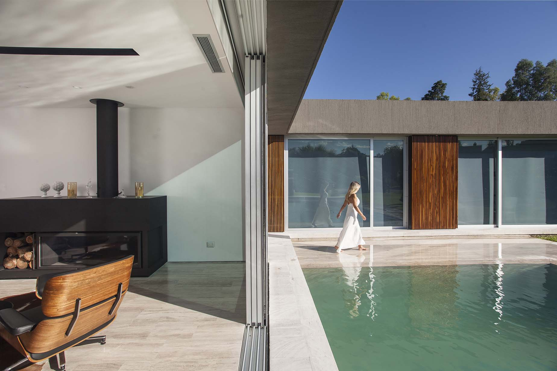 Series of courtyards and walkways creates a smart indoor-outdoor interplay at House PR