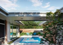 Shelered-outdoor-spaces-and-pool-area-at-the-revamped-home-in-Austin