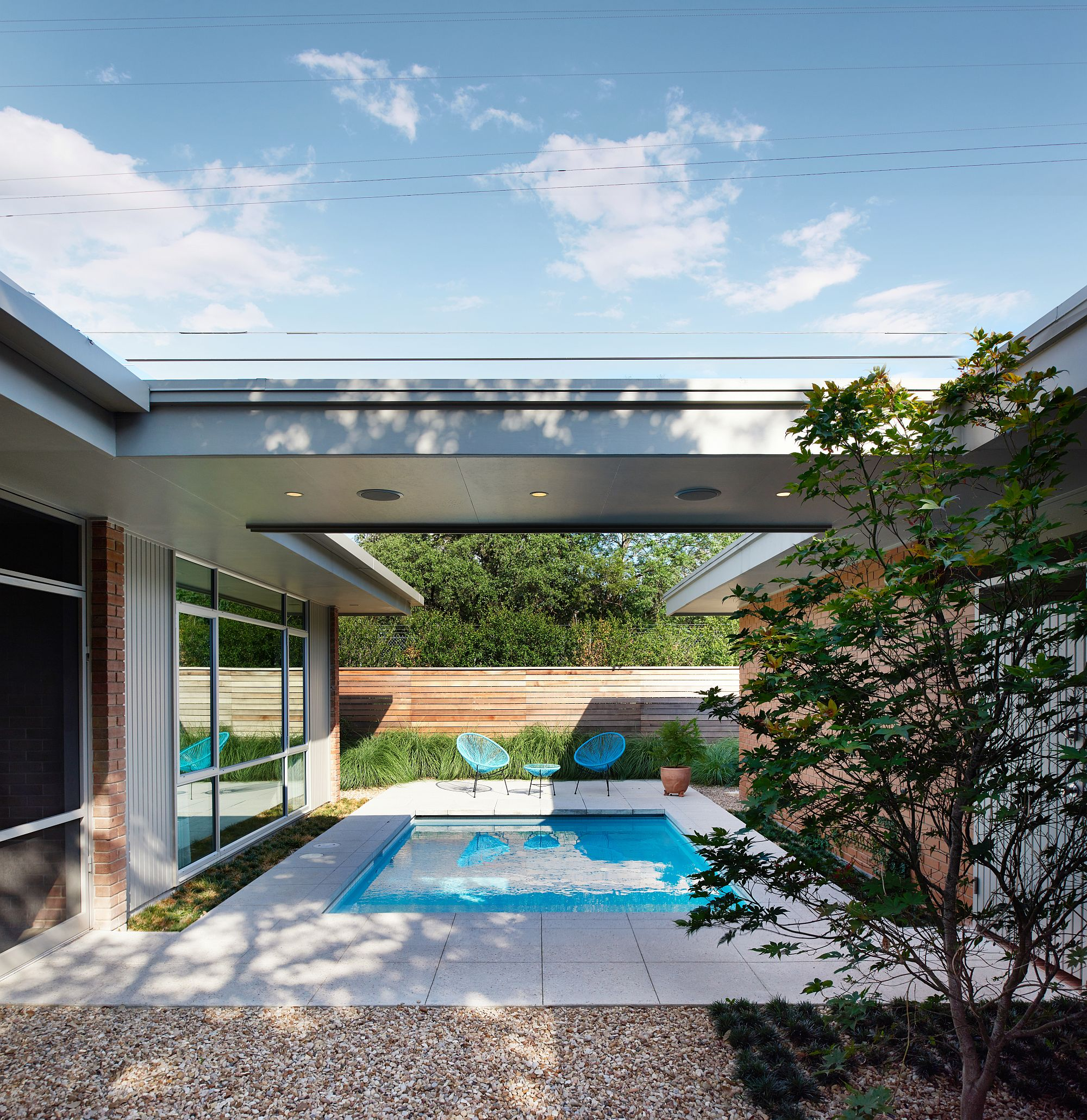 Sheltered outdoor spaces and pool area at the revamped home in Austin
