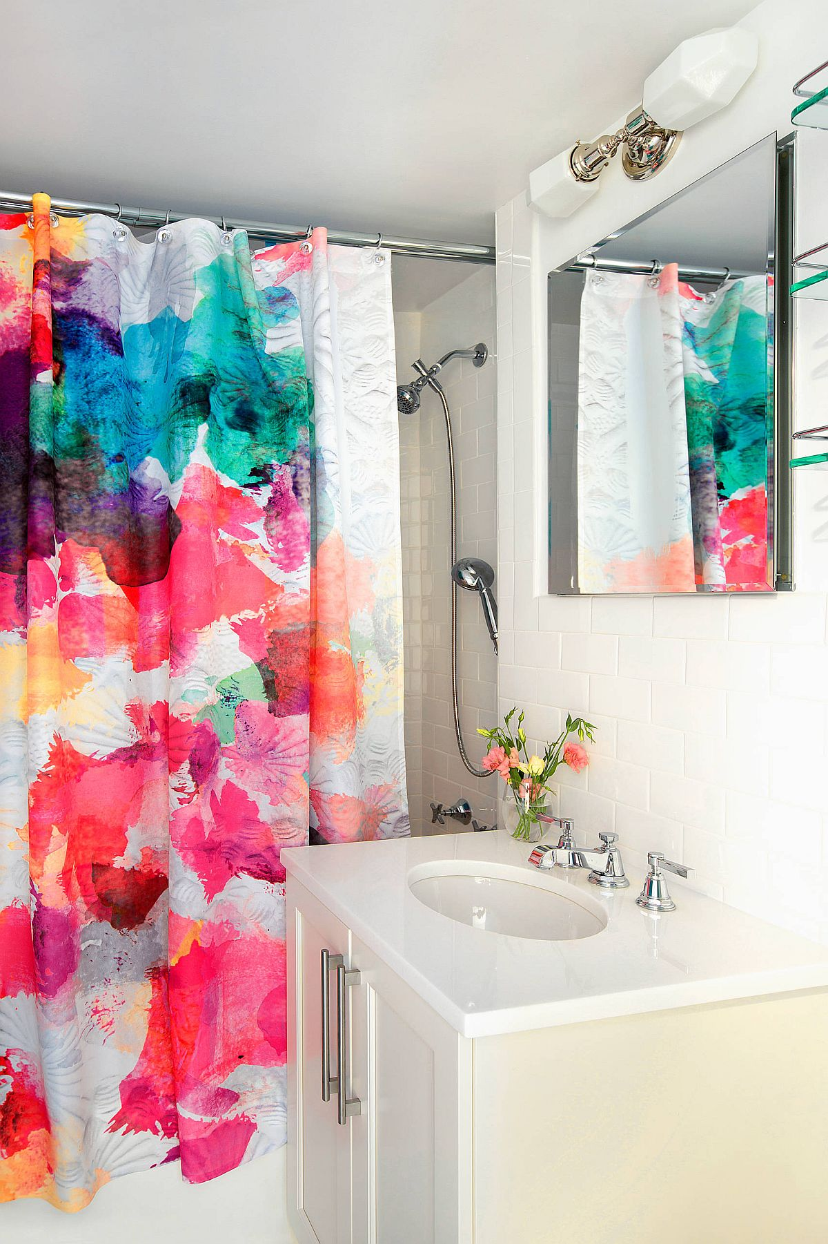 Shower curtains bring splashes of pink and purple into this modern, neutral bathroom