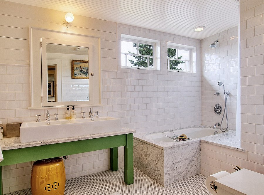 Simple wooden vanity in green brings color to this white bathroom