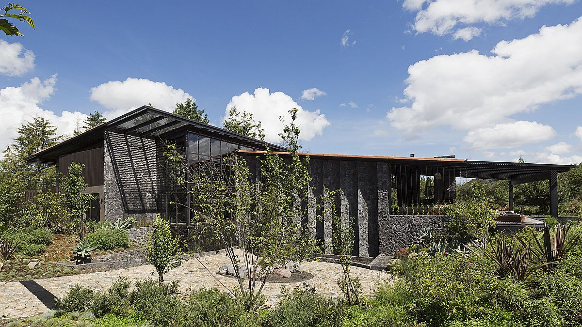 Slanting-roof-forms-and-stone-wall-made-from-dark-locally-sourced-volcanic-rock-for-the-Mexican-Weekend-home-93871