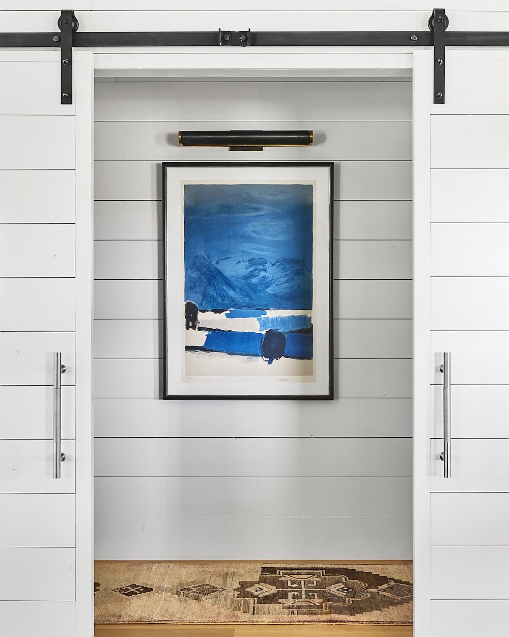 Sliding barn style door for the home preserve its classic ranch style