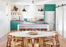 Small-and-elegant-ranch-style-kitchen-in-Texas-home-with-tiled-backsplash-and-teal-cabinets-47382-217x155